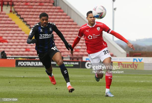 Barnsley's Toby Sibbick vies for possession with Middlesbrough's Chuba Akpom during the Sky Bet Championship match between Barnsley and Middlesbrough...