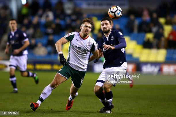 Barnsley's Tom Bradshaw battles for the ball against Millwall's Conor McLaughlin during The Emirates FA Cup Third Round match between Millwall and...