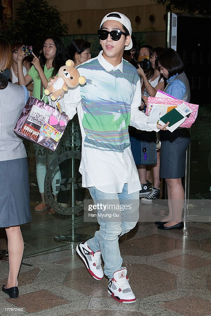 Baro of South Korean boy band B1A4 is seen on departure at Gimpo International Airport on August 26, 2013 in Seoul, South Korea.
