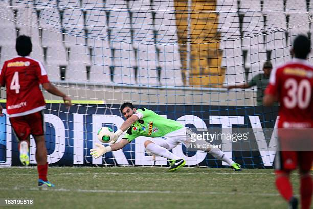 Baroja Alain of Caracas FC in action during a match between AC Mineros de Guayana and Caracas FC as part of the Apertura 2013 at Cachamay Stadium on...