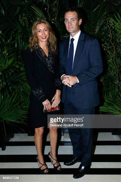 Baron Alexandre de Rothschild and his wife Olivia de Rothschild attend the 'Diner des Amis de Care' at Hotel Peninsula Paris on October 9 2017 in...