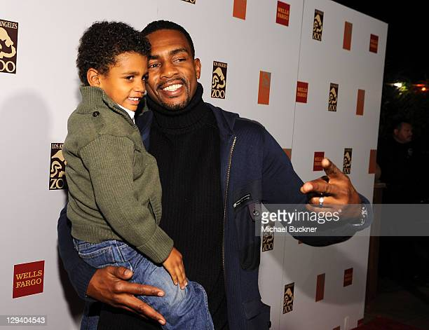 Baron Bellamy and actor Bill Bellamy attend the opening celebration for The Asian Elephant Habitat at the Los Angeles Zoo on December 15 2010 in Los...