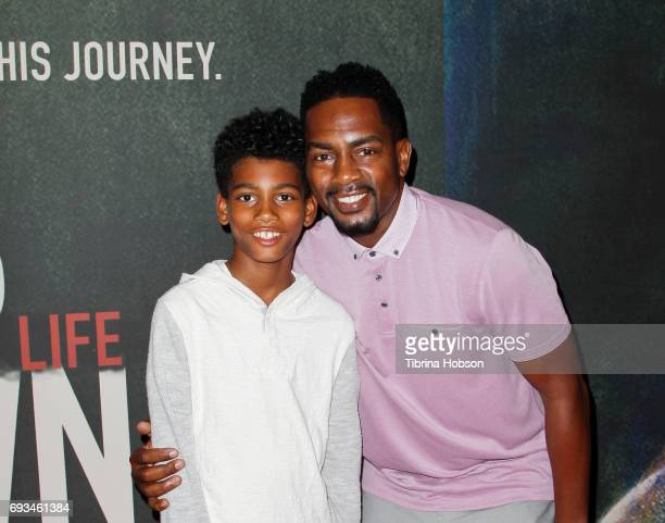 Baron Bellamy and Bill Bellamy attend the premiere of Fathom Events 'Chris Brown Welcome To My Life' at Regal LA Live Stadium 14 on June 6 2017 in...