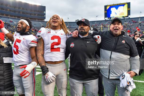 Baron Browning Chase Young Defensive Coach Al Washington and Head Football Coach Ryan Day of the Ohio State Buckeyes celebrate after a college...