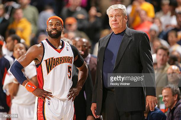 Baron Davis and head coach Don Nelson of the Golden State Warriors look on during the NBA game against the Indiana Pacers on January 13 2008 at...
