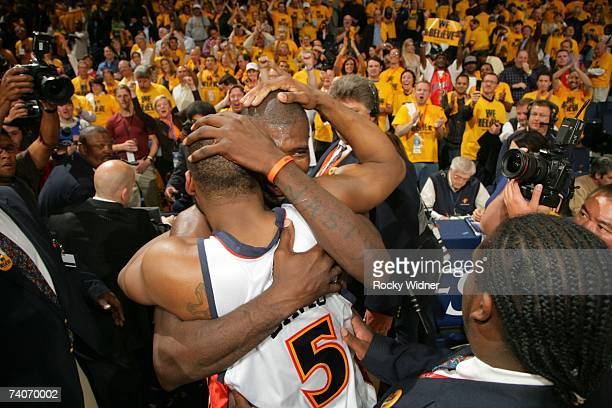 Baron Davis and Jason Richardson of the Golden State Warriors embrace after the victory against the Dallas Mavericks in Game Six of the 2007 NBA...