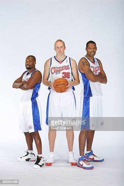 Baron Davis Chris Kaman and Marcus Camby of the Los Angeles Clippers pose for a portrait during NBA Media Day on September 29 2008 at the Clippers...