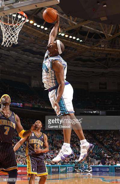 Baron Davis of the Charlotte Hornets dunks the ball against the Indiana Pacers at the Charlotte Coliseum in Charlotte North Carolina DIGITAL IMAGE...