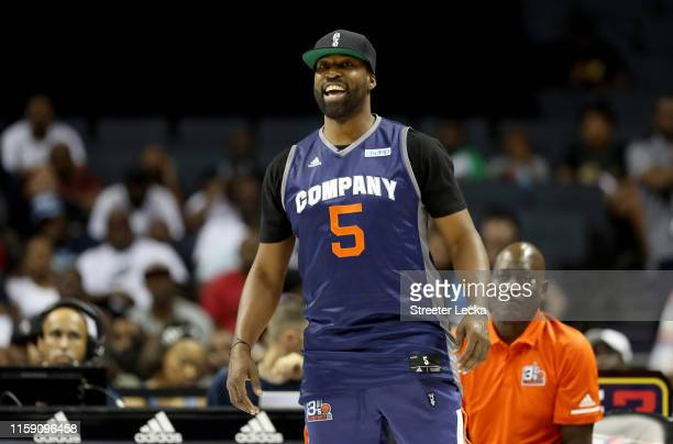 Baron Davis of the Charlotte Hornets watches the game between Ball Hogs and Enemies during week two of the BIG3 three on three basketball league at...