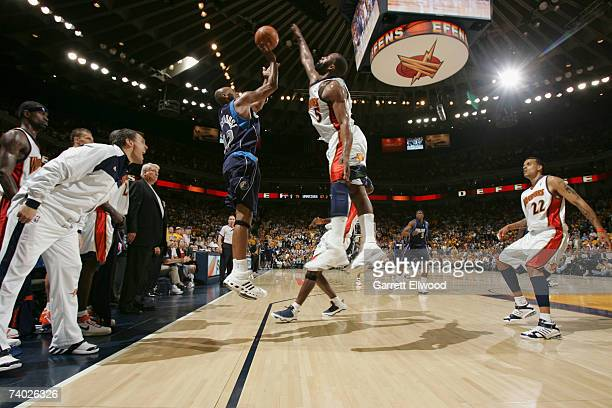 Baron Davis of the Golden State Warriors blocks the shot of Jerry Stackhouse of the Dallas Mavericks in Game Four of the Western Conference...