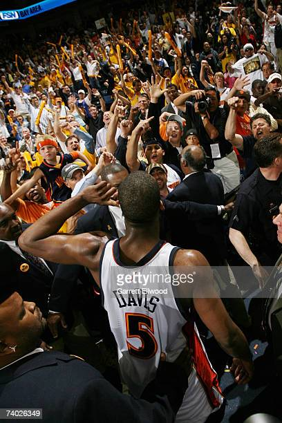 Baron Davis of the Golden State Warriors celebrates with fans after the game against the Dallas Mavericks in Game Four of the Western Conference...