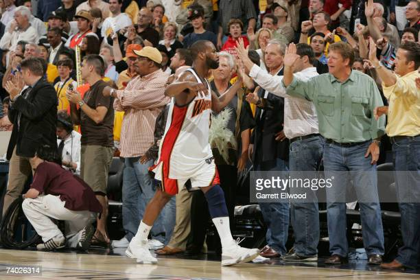 Baron Davis of the Golden State Warriors celebrates with fans against the Dallas Mavericks in Game Four of the Western Conference Quarterfinals...