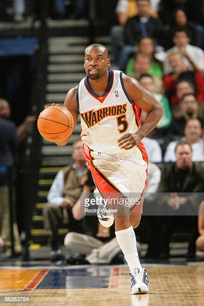 Baron Davis of the Golden State Warriors drives against the New Jersey Nets during the game at the Arena in Oakland on November 21 2005 in Oakland...
