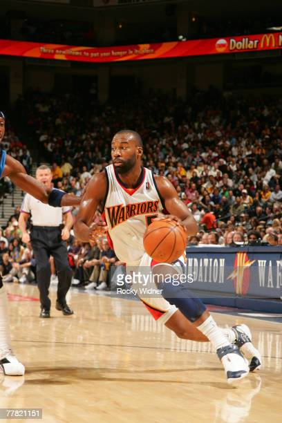 Baron Davis of the Golden State Warriors drives to the basket against the Dallas Mavericks on November 8 2007 at Oracle Arena in Oakland California...