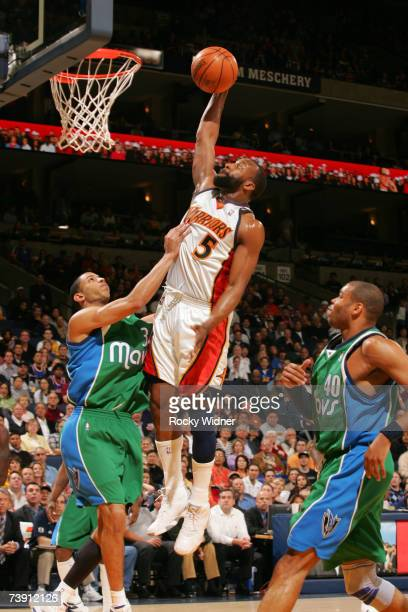 Baron Davis of the Golden State Warriors flies to the basket against the Dallas Mavericks on April 17, 2007 at Oracle Arena in Oakland, California....