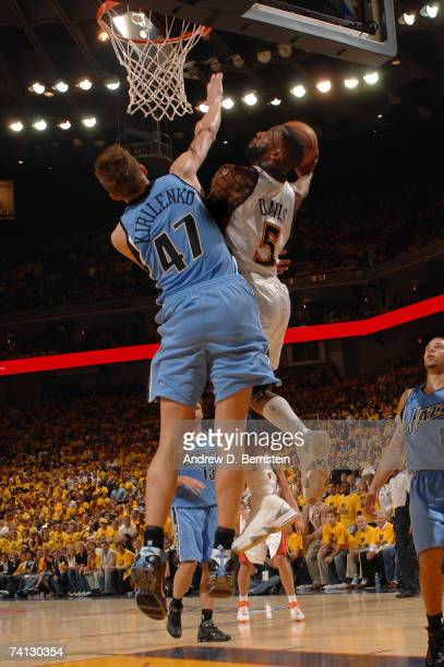Baron Davis of the Golden State Warriors goes strong to the hoop against Andrei Kirilenko of the Utah Jazz in Game Three of the Western Conference...