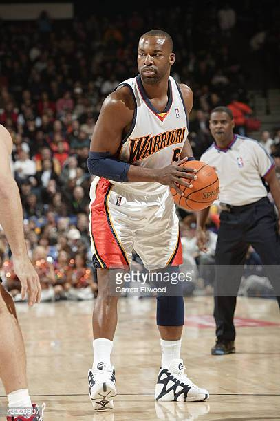 Baron Davis of the Golden State Warriors holds the ball against the New Jersey Nets on January 24 2007 at Oracle Arena in Oakland California The...
