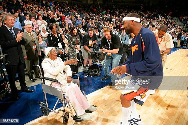 Baron Davis of the Golden State Warriors is surprised by a visit from his grandmother courtside her first time at seeing her grandson play live in...