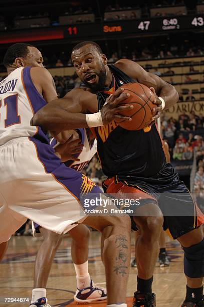 Shawn baron pictures and photos getty images baron davis of the golden state warriors looks to drive around shawn marion of the phoenix thecheapjerseys Image collections