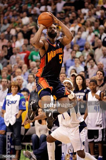 Baron Davis of the Golden State Warriors makes a shot from the field against Jason Terry of the Dallas Mavericks in the fourth quarter of Game Five...