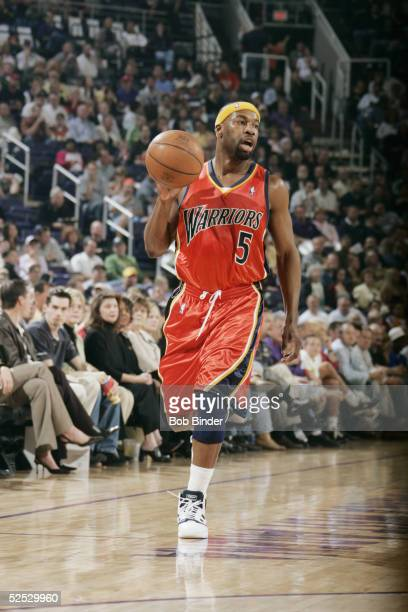 Baron Davis of the Golden State Warriors moves the ball during the game against the Phoenix Suns on March 18 2005 at America West Arena in Phoenix...
