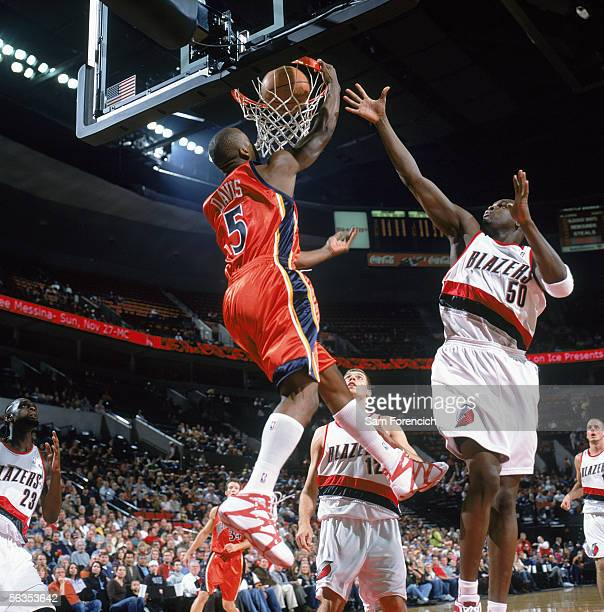 Baron Davis of the Golden State Warriors reaches for the basket against Zach Randolph of the Portland Trail Blazers at The Rose Garden on November 18...