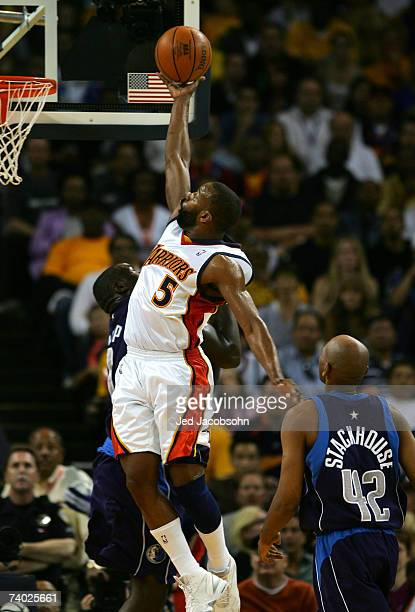 Baron Davis of the Golden State Warriors shoots over Jerry Stackhouse of the Dallas Mavericks in Game Four of the Western Conference Quarterfinals...