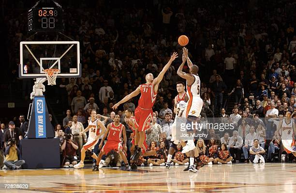 Baron Davis of the Golden State Warriors shoots the game winning 3pointer over Shane Battier of the Houston Rockets on December 14 2006 at the Oracle...