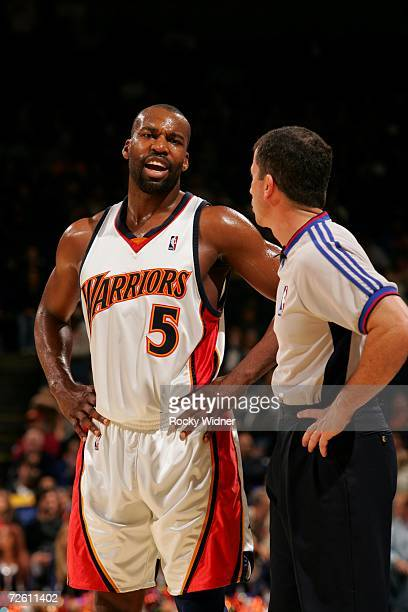 Baron Davis of the Golden State Warriors talks to referee Tim Donaghy during the game against the Toronto Raptors on November 14, 2006 at Oracle...