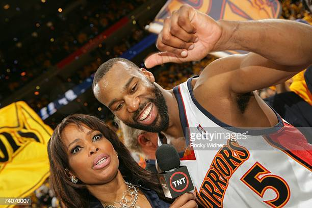 Baron Davis of the Golden State Warriors talks to TNT reporter Pam Oliver after the victory against the Dallas Mavericks in Game Six of the 2007 NBA...