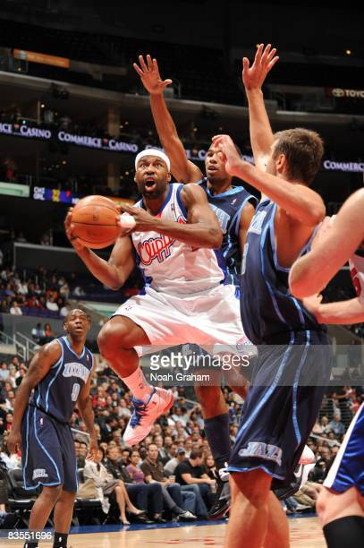 Baron Davis of the Los Angeles Clippers avoids contact while attempting a shot against the Utah Jazz at Staples Center on November 3 2008 in Los...