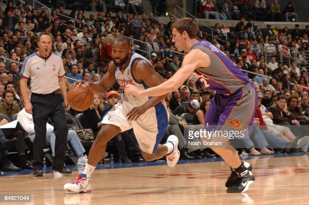 Baron Davis of the Los Angeles Clippers drives against Goran Dragic of the Phoenix Suns at Staples Center on February 18 2009 in Los Angeles...