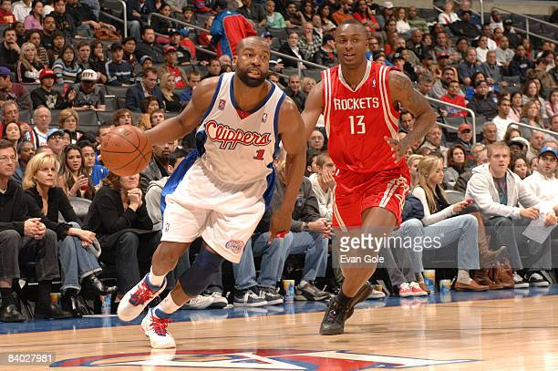 Baron Davis of the Los Angeles Clippers drives against Von Wafer of the Houston Rockets at Staples Center on December 13 2008 in Los Angeles...
