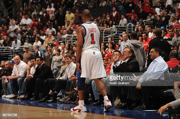 Baron Davis of the Los Angeles Clippers looks on while team owner Donald Sterling questions a call during a game against the New Orleans Hornets at...