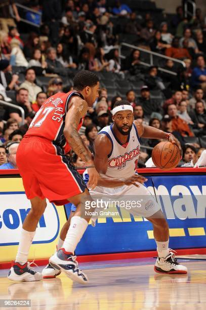 Baron Davis of the Los Angeles Clippers moves the ball against Chris DouglasRoberts of the New Jersey Nets during the game at Staples Center on...