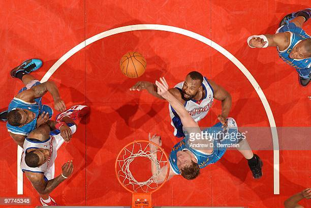 Baron Davis of the Los Angeles Clippers puts up a shot against Darius Songaila of the New Orleans Hornets at Staples Center on March 15 2010 in Los...
