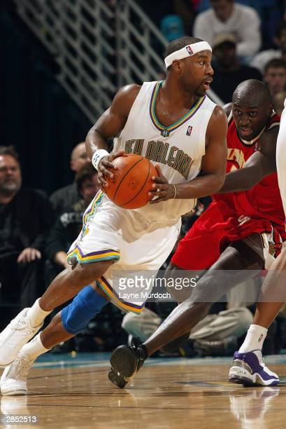 Baron Davis of the New Orleans Hornets drives against the Atlanta Hawks during the game at New Orleans Arena on December 26 2003 in New Orleans...