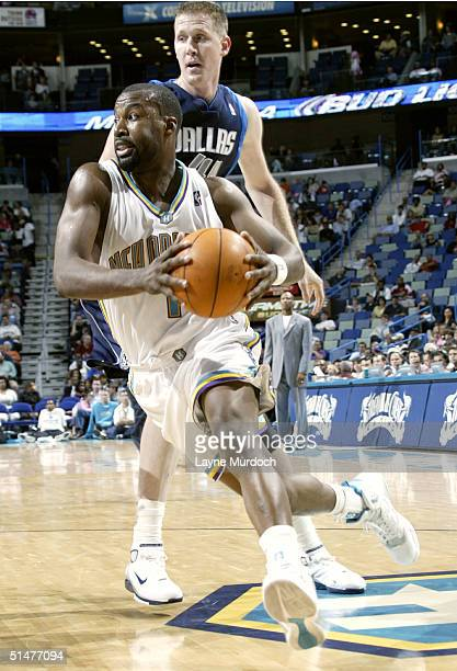 Shawn baron pictures and photos getty images baron davis of the new orleans hornets drives the ball around shawn bradley of the dallas thecheapjerseys Image collections