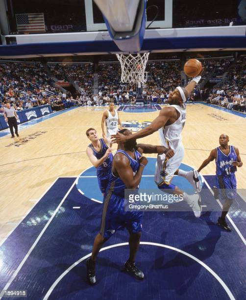 Orlando magic shawn kemp stock photos and pictures getty images baron davis of the new orleans hornets takes the ball up over shawn kemp of the altavistaventures Images