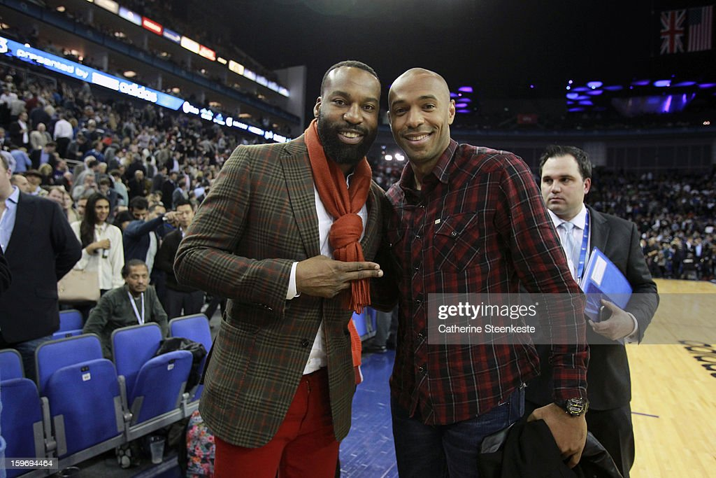 Baron Davis of the New York Knicks poses with Thierry Henry soccer player of the New York Red Bulls during a game between New York Knicks and the Detroit Pistons at the O2 Arena on January 17, 2013 in London, England.