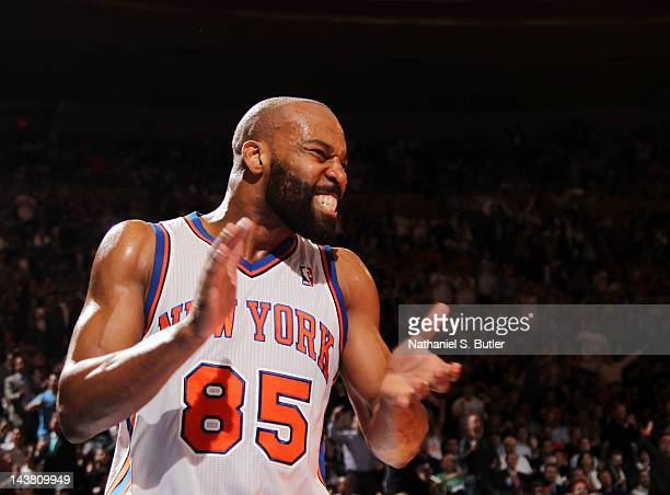 Baron Davis of the New York Knicks reacts to the game action in Game Three of the Eastern Conference Quarterfinals against the Miami Heat during the...