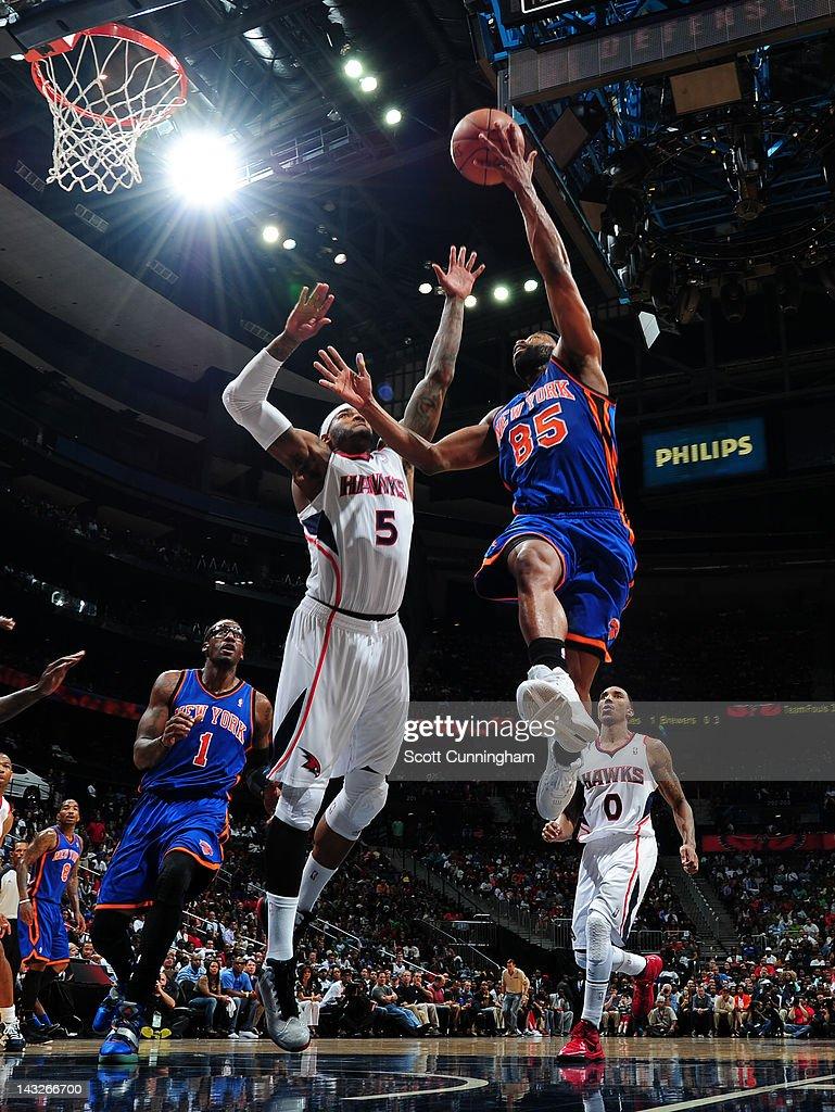 Baron Davis #85 of the New York Knicks shoots against Josh Smith #5 of the Atlanta Hawks on April 22, 2012 at Philips Arena in Atlanta, Georgia.