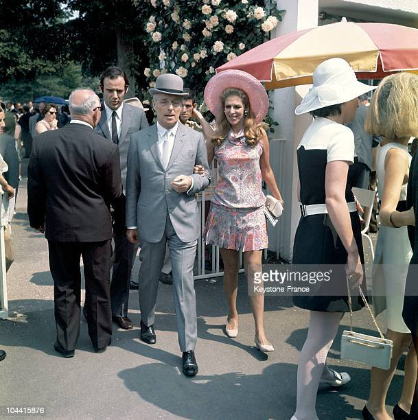Baron Guy de ROTHSCHILD and his spouse Helene arriving at the Paris racetrack
