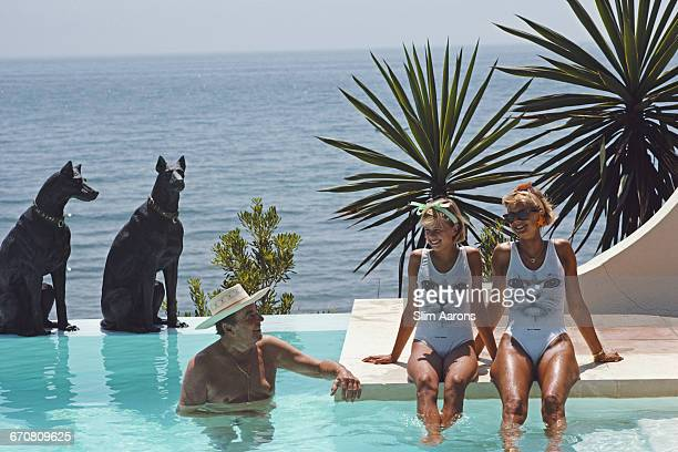Baron Hubert von Pantz with two of his guests Princess Johanna zu SaynWittgenstein and her daughter Countess Leonille Grafin Douglas by the pool of...