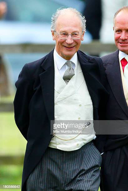 Baron Robert Fellowes attends the wedding of James Meade and Lady Laura Marsham at the Parish Church of St Nicholas in Gayton on September 14 2013...