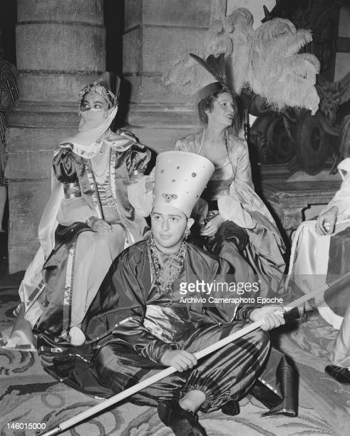 Baroness Afdera Franchetti Marella Agnelli and Filippo Lacloche at a masked costume ball at the Palazzo Labia Venice 3rd September 1951 Named 'Le Bal...