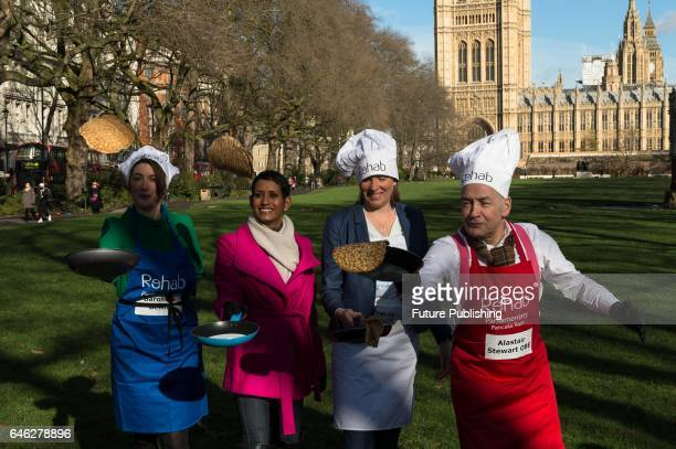 Baroness Bertin BBC presenter Naga Munchetty Tracey Crouch MP and ITV presenter Alastair Stewart practice flipping their pancakes as they take part...