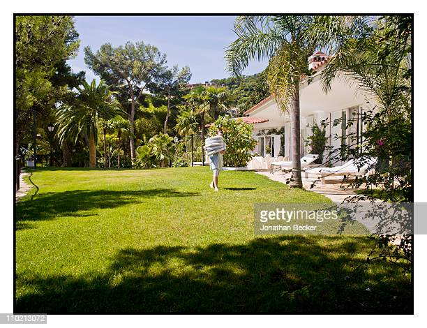 Baroness Carmen von Thyssen's maid is photographed walking through the garden for Vanity Fair Spain on August 24 2010 in Sant Feliu Spain Published...