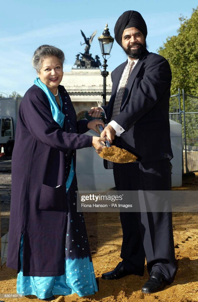 Baroness Flather, Chair of the Memorial Gates Trust, performs a 'ceremonial sod-cutting' at the start of the construction of the ceremonial gates on Constitution Hill, London on. * The gates will commemorate the part played by five million men and women from the Indian sub-continent, Africa and the Caribbean who served as volunteers with the British Armed Forces during both World Wars.