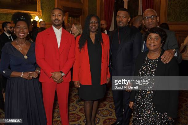 Baroness Floella Benjamin Michael B Jordan Marsha De Cordova MP Jamie Foxx Lord Simon Woolley and Baroness Doreen Lawrence attend an evening at the...